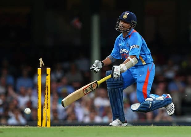 Sachin Tendulkar of India is run out by David Warner of Australia during the One Day International match between Australia and India at Sydney ground