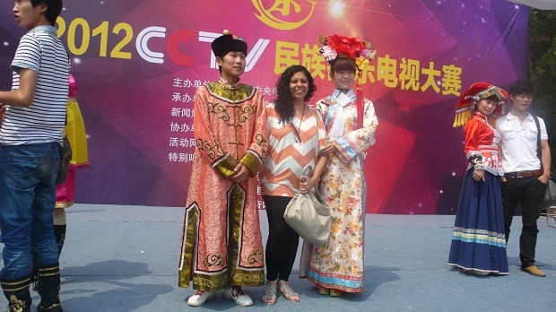 With students in traditional dress