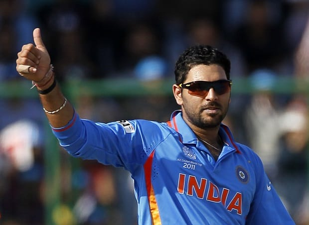 India's Yuvraj Singh celebrates taking the wicket of The Netherlands' Wesley Baressi during their ICC Cricket World Cup group B match in New Delhi